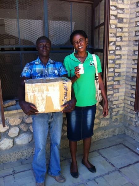 Nurse Timay with Gildna picking up Vitamin Angel prenatal vitamins at Albert Schweitzer Hospital in Deschapelles, Haiti.