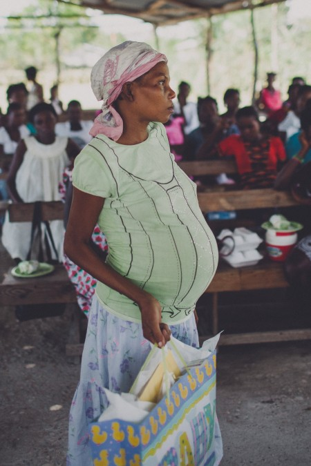 One of the mothers in the pregnancy program receiving her baby gifts.