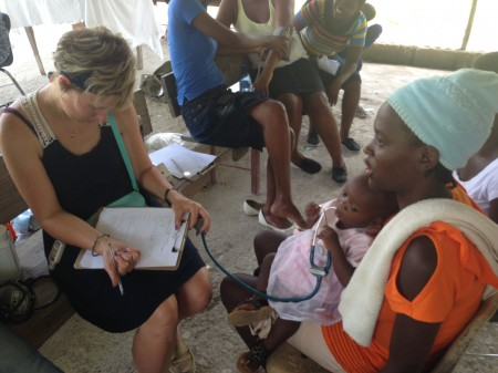 Nurse Rachelle treating a family at the medical clinic.