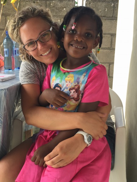 Ashley Stills with our house host/cook's daughter. We sure do enjoying loving on these sweet families.