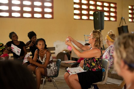Our founder and leader, Ashley Stills showing the teenage girls how to fold the cup for insertion.